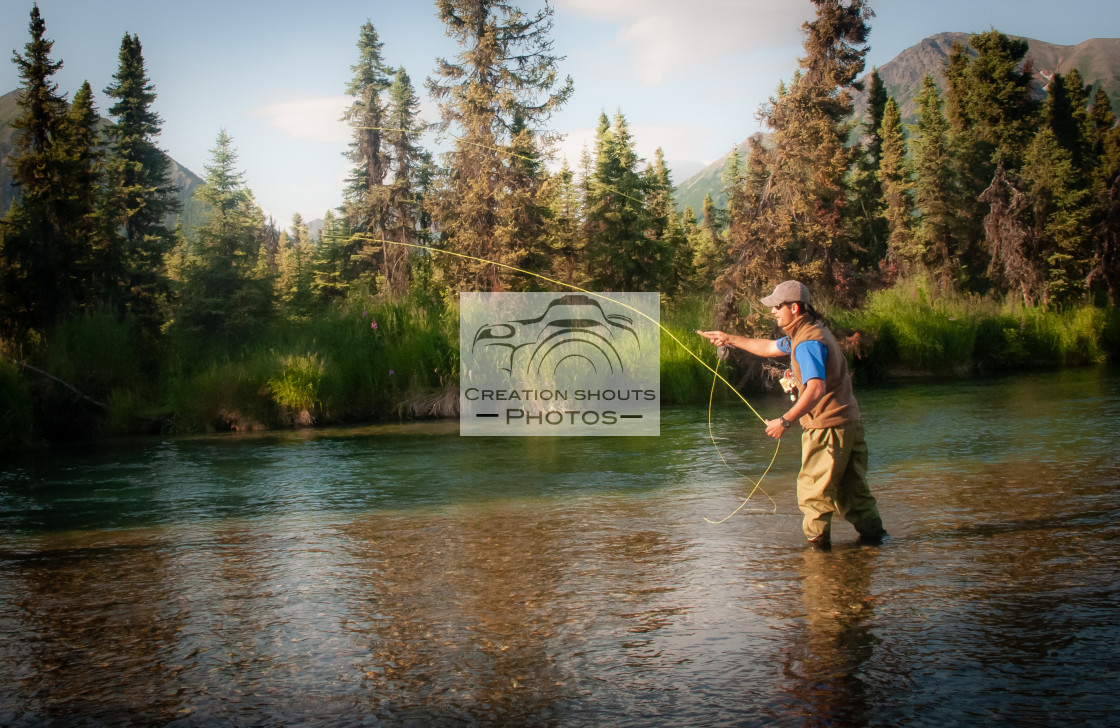 """Fly Fishing During Salmon Run in Kijik River"" stock image"