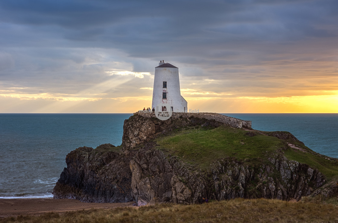 """Twr Mawr Lighthouse at sunset"" stock image"