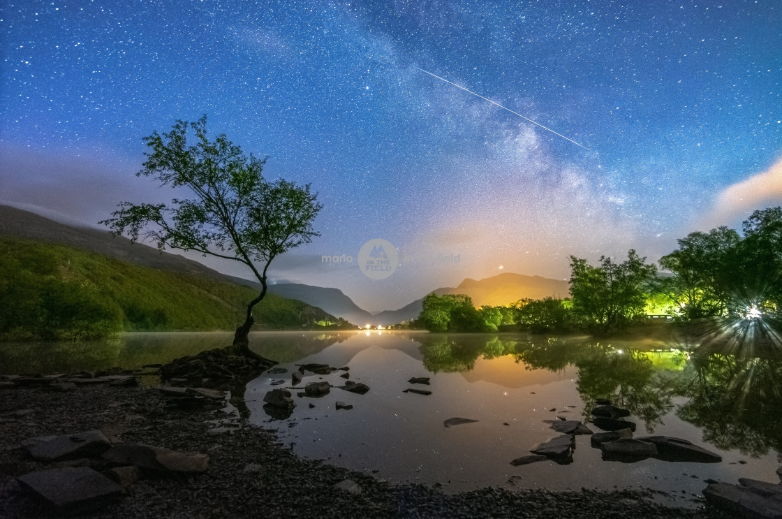 """Milky Way and meteor over the Llyn Padarn"" stock image"