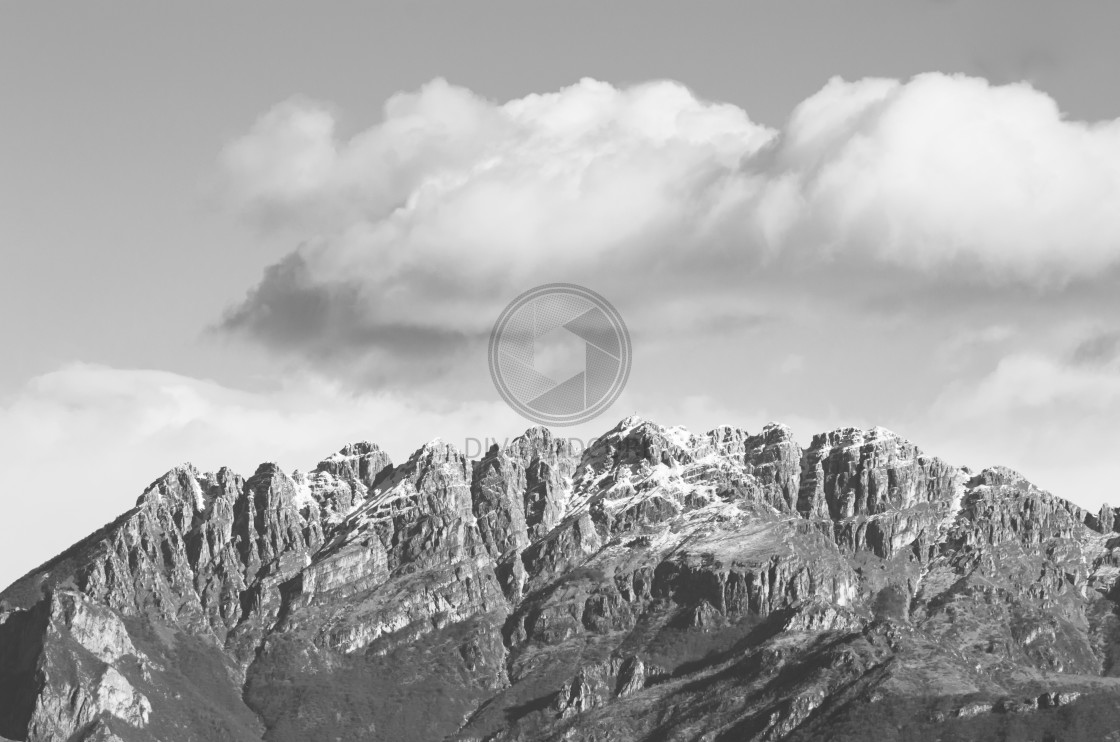 """northern italy prealps snowy peaks under clear sky"" stock image"