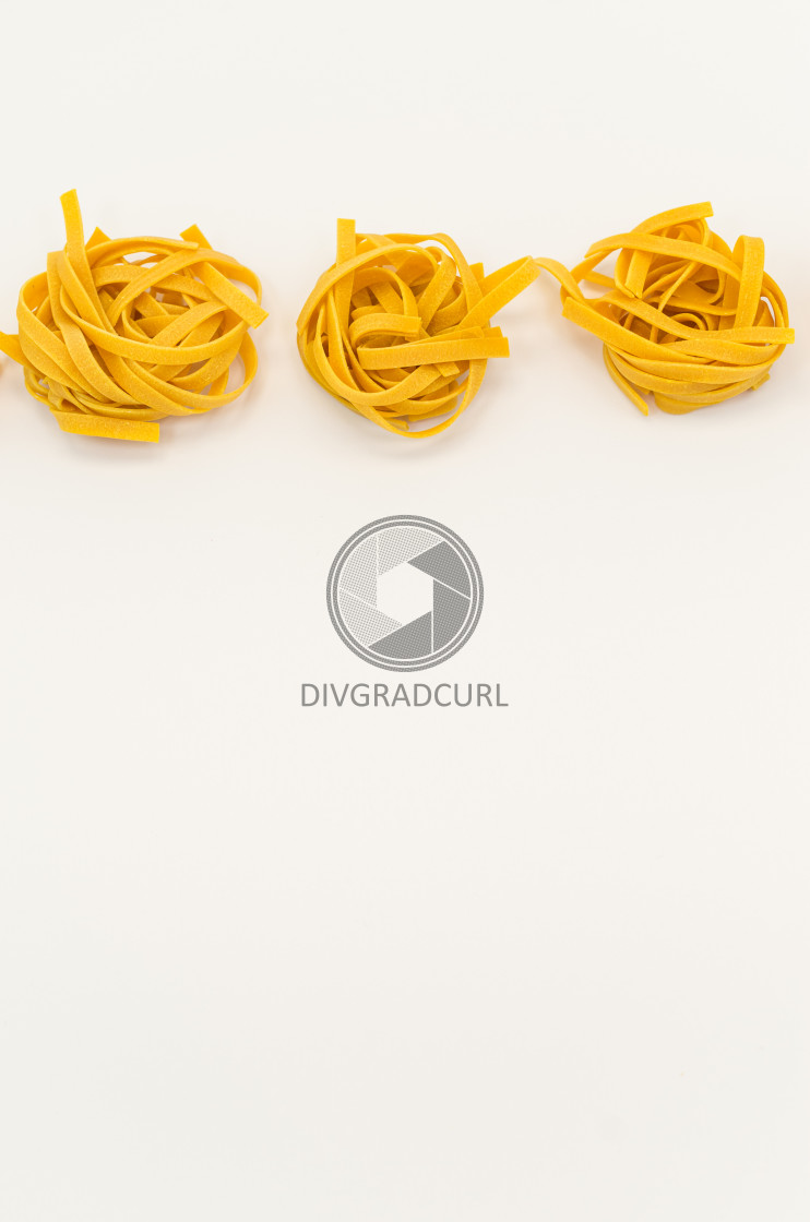 """italian tagliatelle pasta on a white background"" stock image"