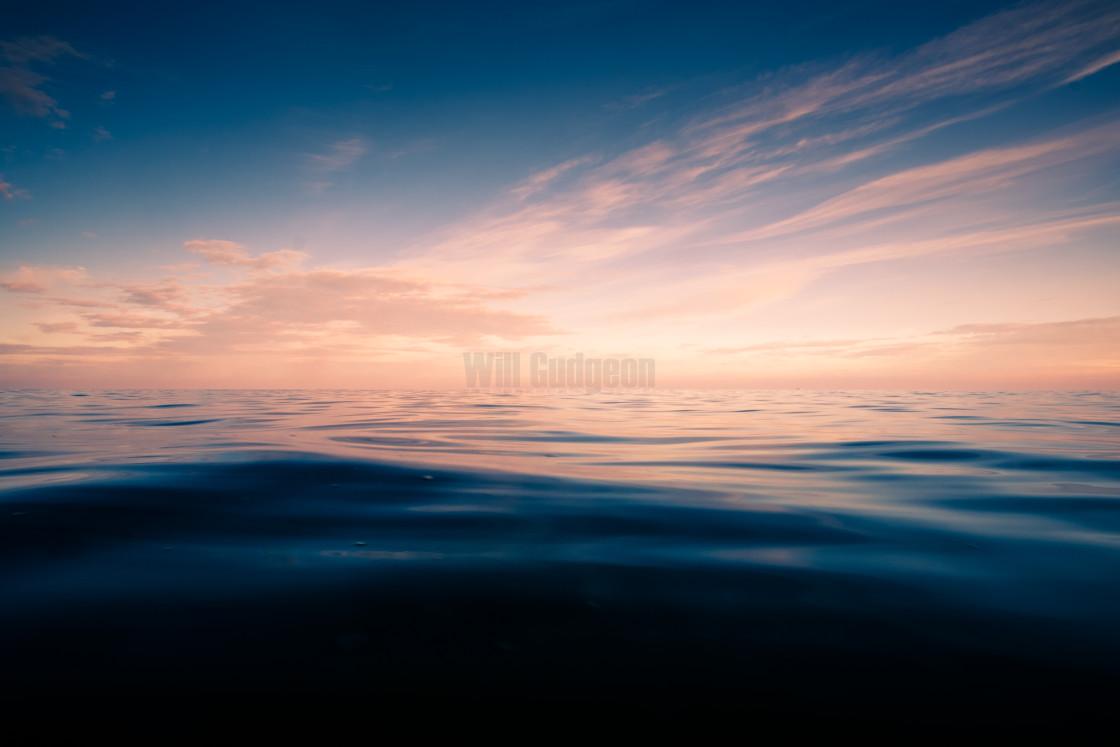 """Tranquil ocean sunset"" stock image"