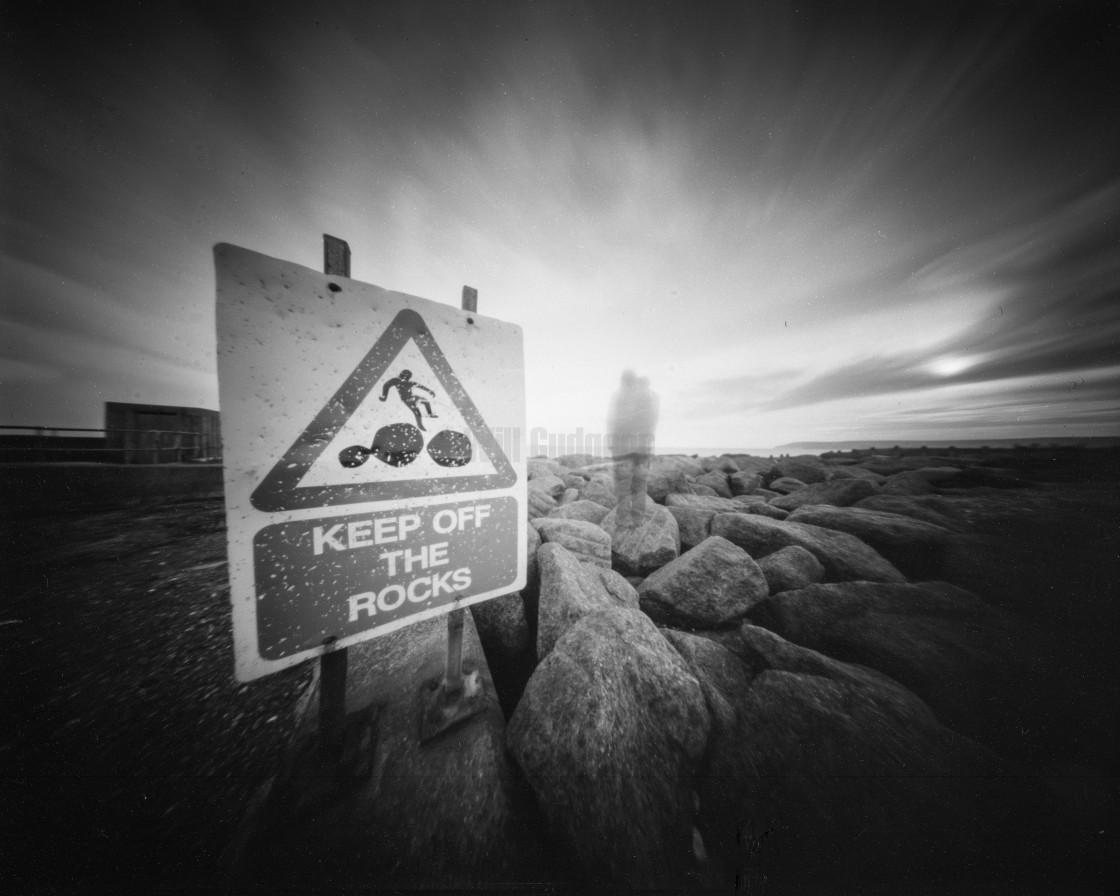 """Keep off the rocks - Pinhole photo."" stock image"