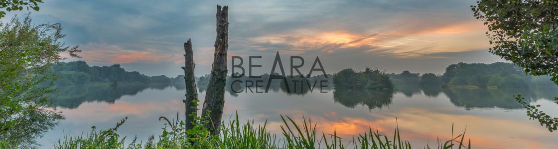 """Tranquil evening lake reflection"" stock image"