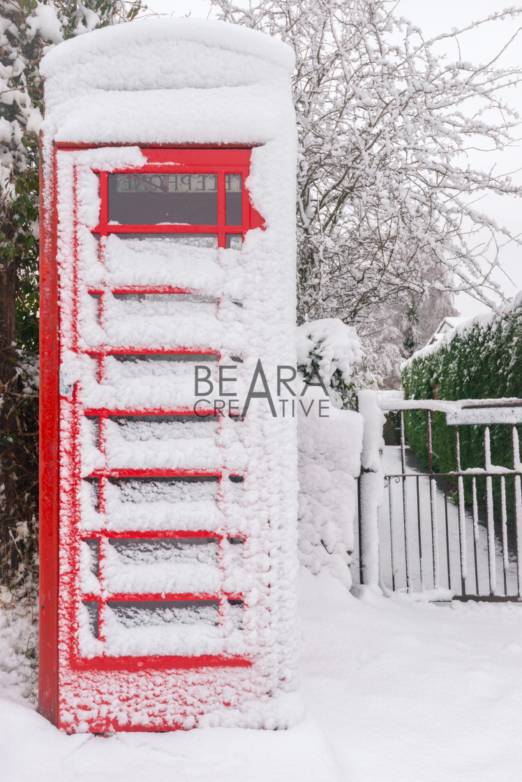 """Snow covered phonebooth"" stock image"