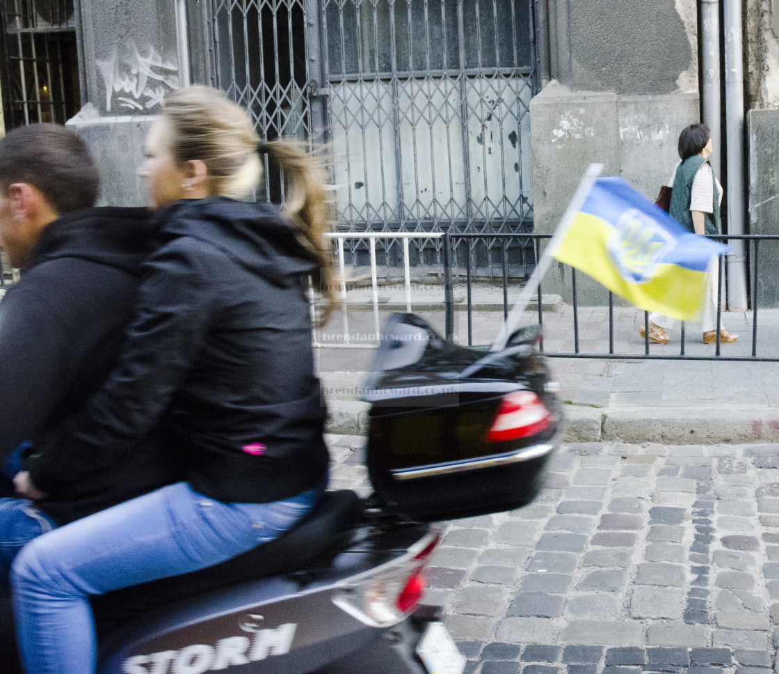"""""""Ride on moped with Ukrainian flag"""" stock image"""