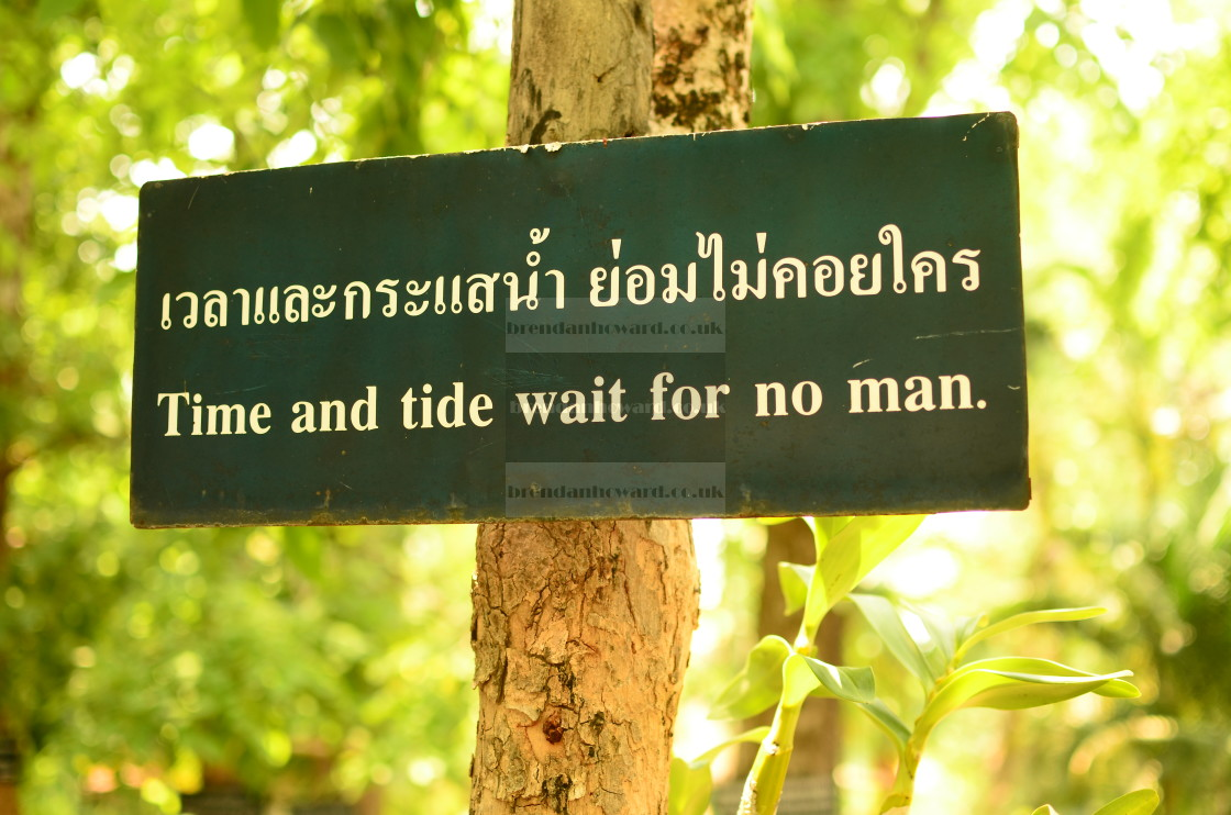 """""""Time and Tide Wait for No Man"""" stock image"""