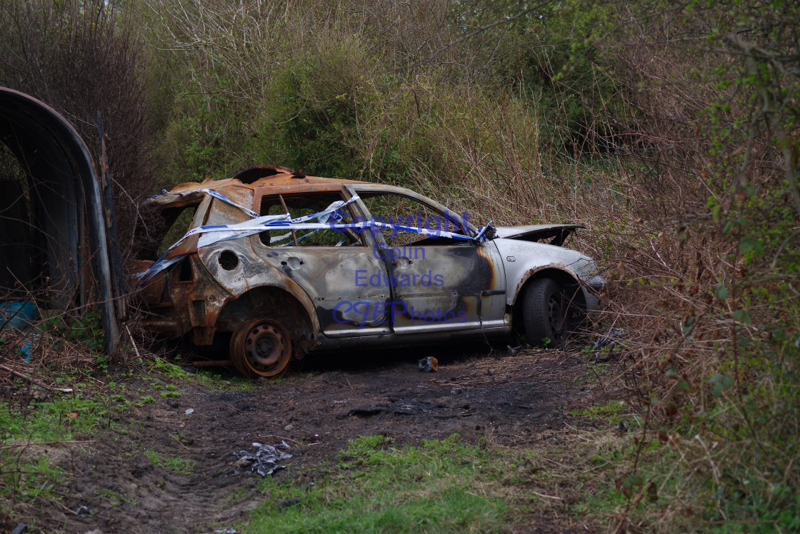 """Derelict car on path, Greenside, England"" stock image"