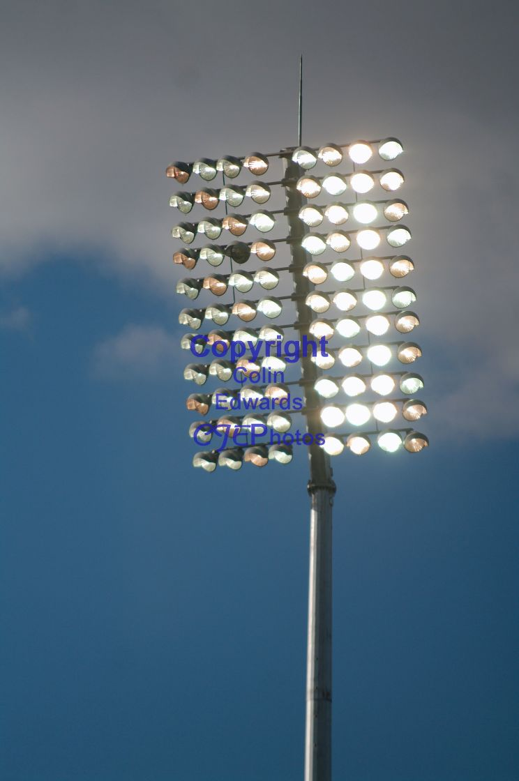"""""""Floodlight, switched on, against a blue sky."""" stock image"""