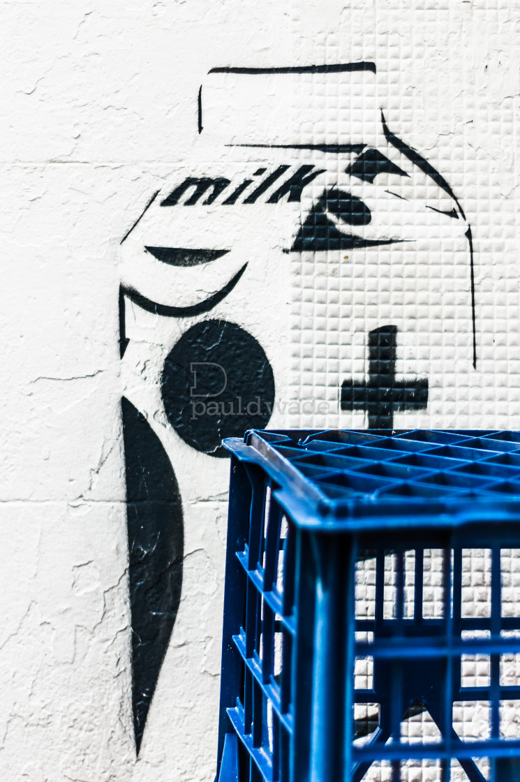 """""""Milk crates in front of a wall with milk carton street art"""" stock image"""