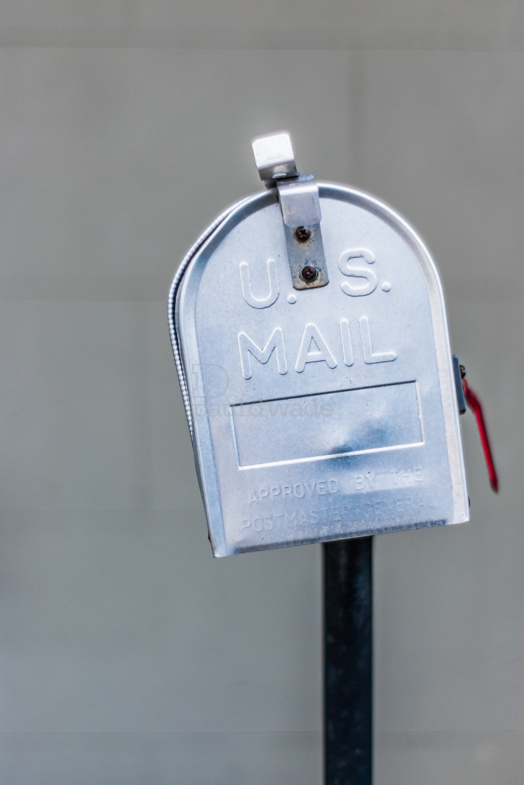 """""""Metal US Mail style mailbox on fence outside a home"""" stock image"""