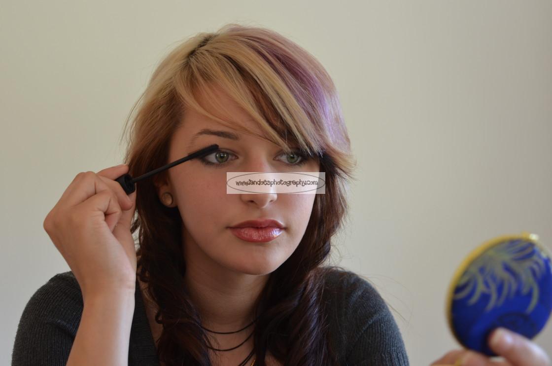 """Teenager applying makeup"" stock image"
