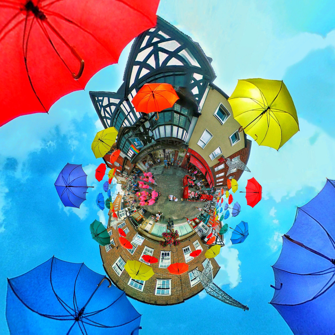 """Umbrellas display in Salisbury (Little planet view)"" stock image"