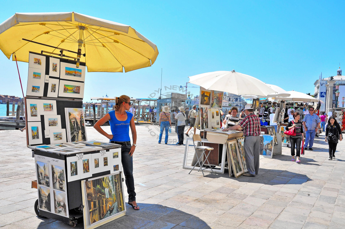 """Street artist displaying paintings in Venice"" stock image"