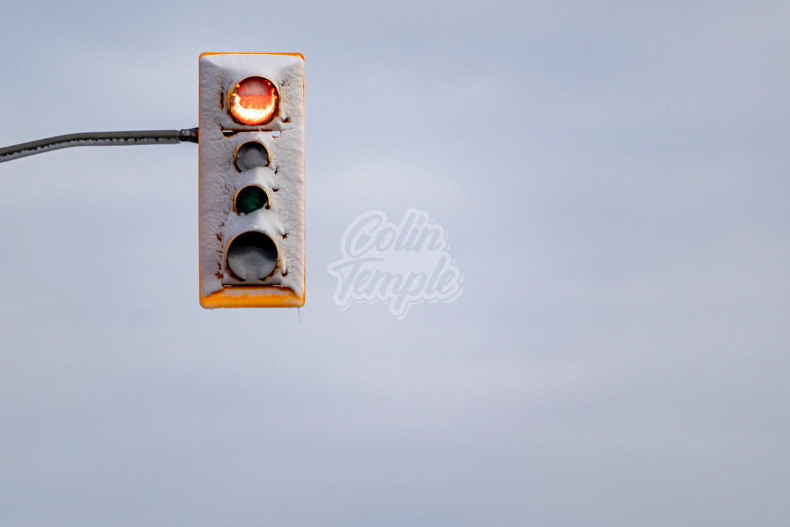 """""""Snow-Blasted Red Traffic Light in Winter"""" stock image"""
