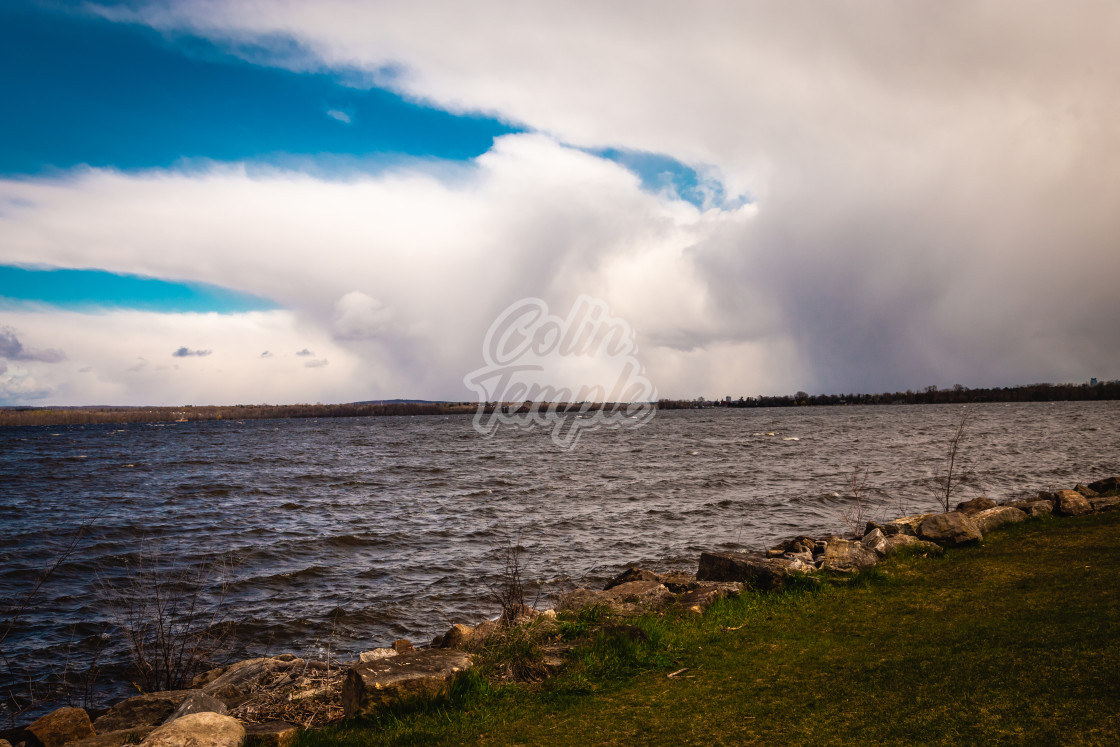 """Rain Coming in Over The River"" stock image"