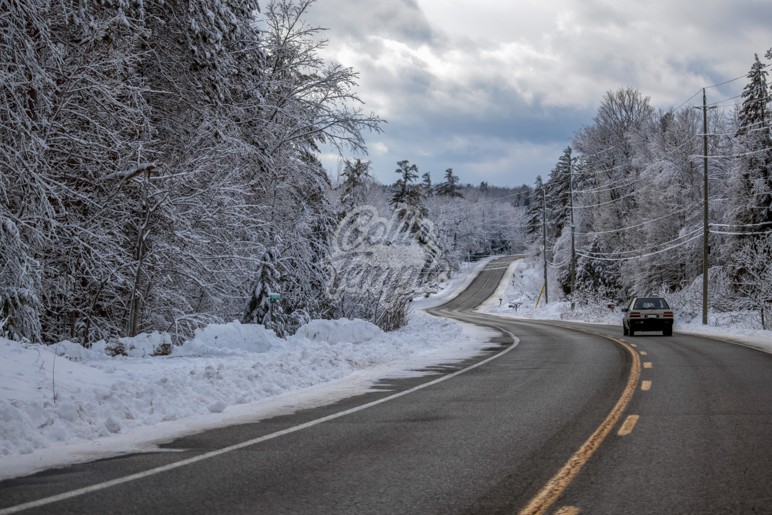 """Driving Down a Winding Winter Country Road"" stock image"