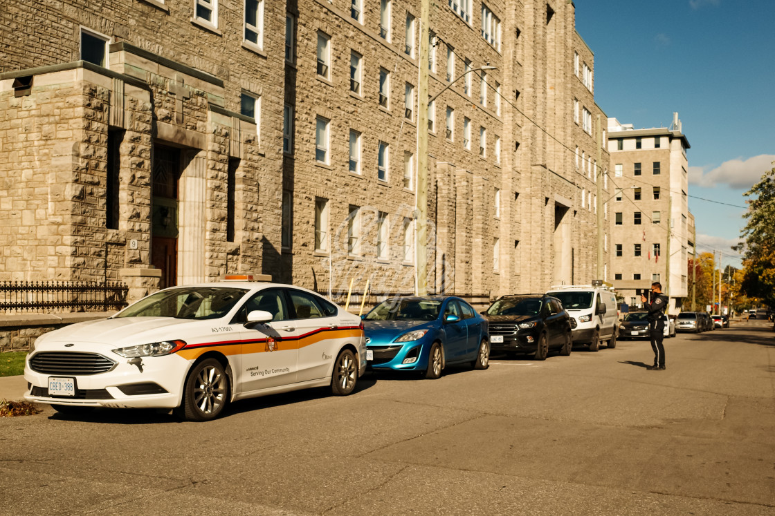 """Ottawa by-law officer enforces parking restrictions"" stock image"