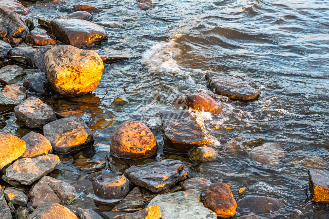 """River Waves on a Rocky Shore"" stock image"
