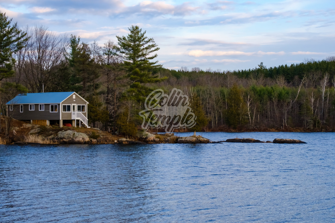 """Raised Cottage on the Lake"" stock image"