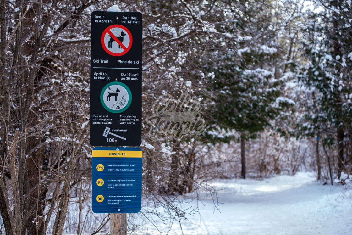 """COVID-19 signage on NCC trail in Ottawa wintertime"" stock image"