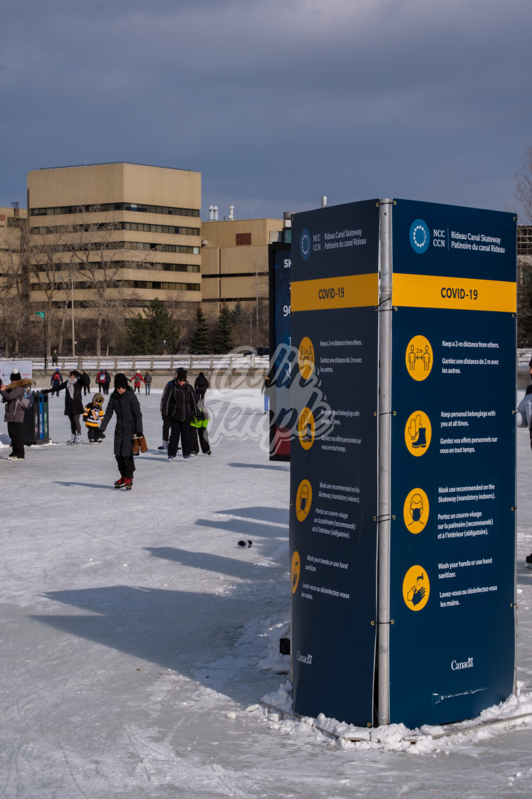 """COVID-19 signs on the RIdeau Canal Skateway, Ottawa"" stock image"