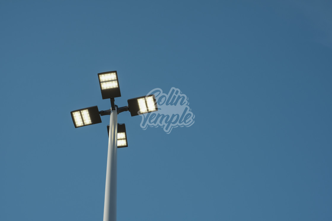 """Street lights viewed from below"" stock image"