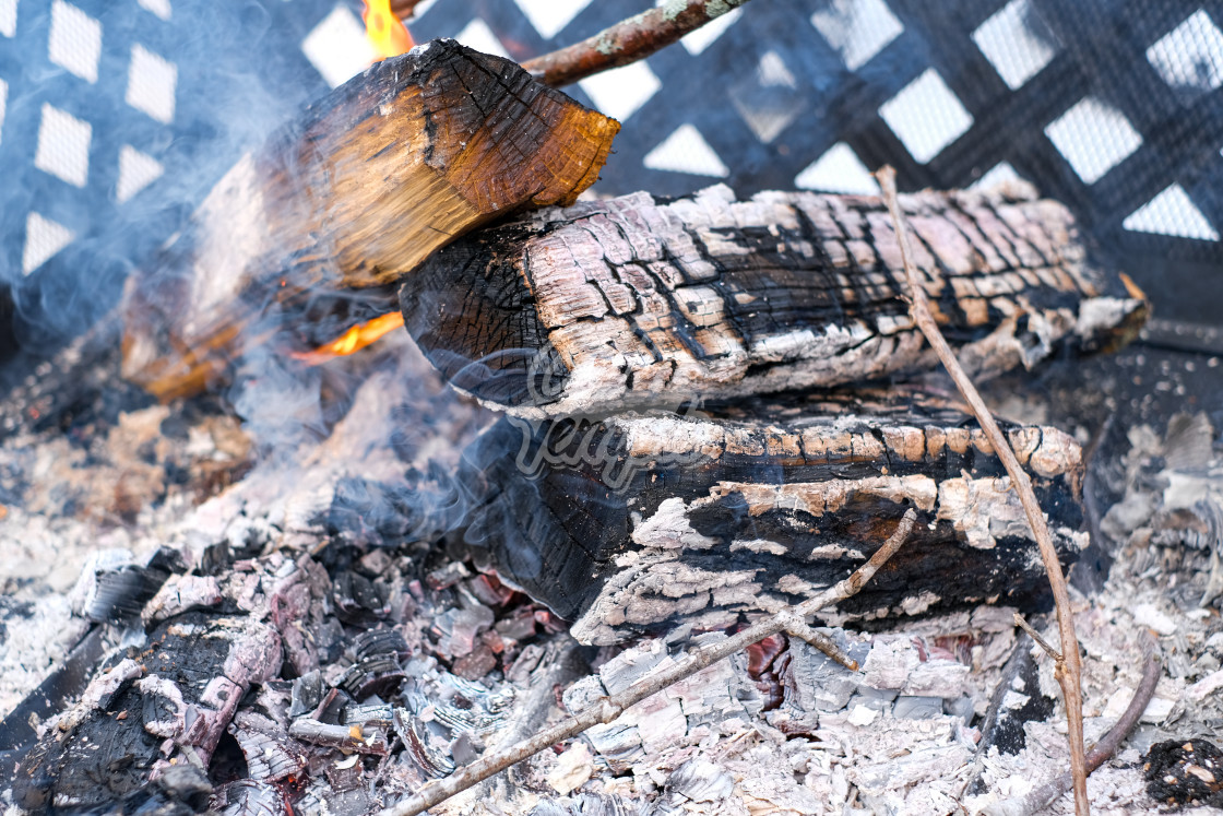 """""""Glowing hot embers in outdoor, daytime fire"""" stock image"""