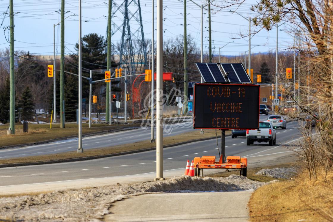 """""""COVID-19 Vaccine Centre sign in Ottawa"""" stock image"""