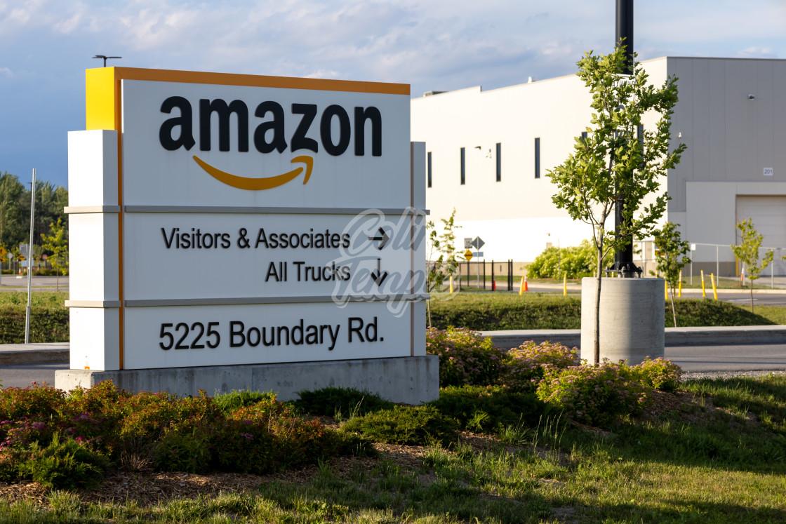 """Amazon sign at warehouse in Ottawa"" stock image"