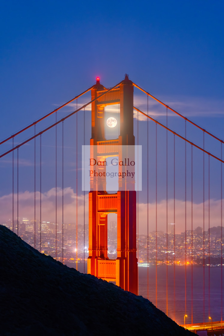 """Moon framed by the Golden Gate Bridge"" stock image"