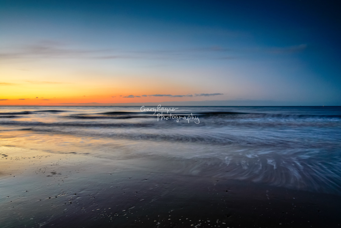 """Twilight on Mundsley Beach"" stock image"