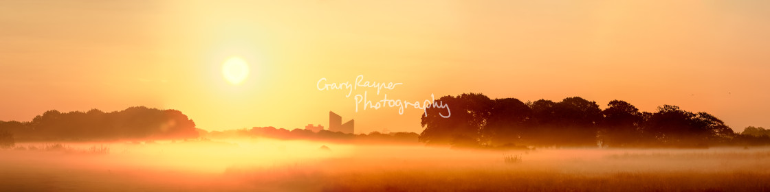 """Misty Golden Sunrise"" stock image"