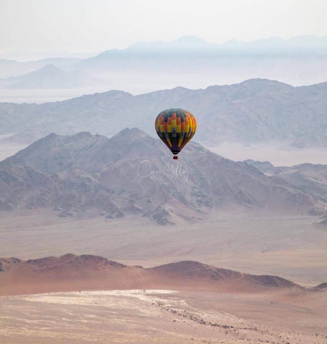 """Hot air balloon over the Namib desert"" stock image"