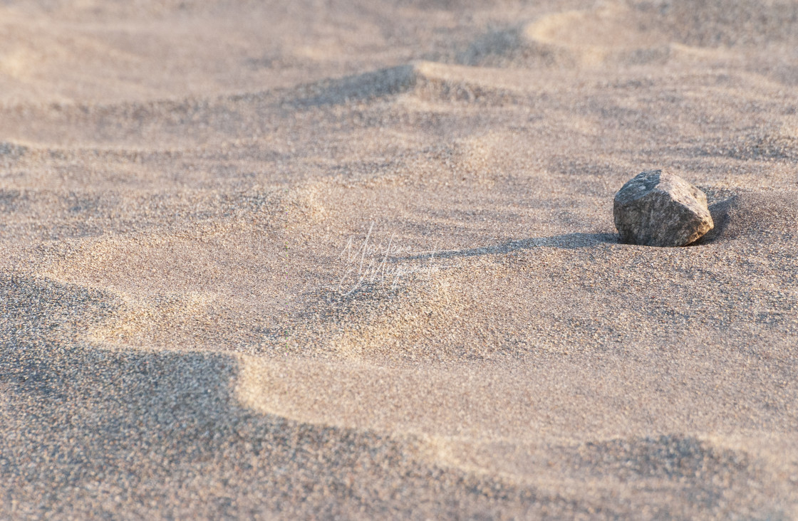 """""""Rock in the Sand"""" stock image"""