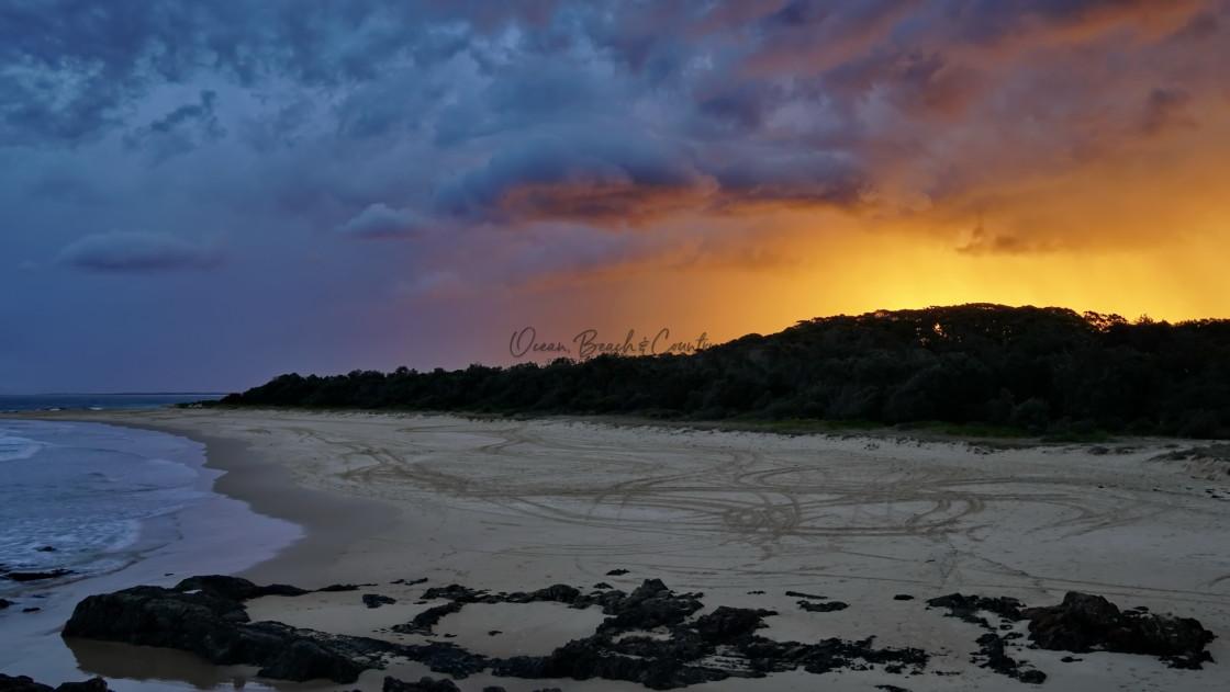 """STORMY BACK BEACH SUNSET"" stock image"