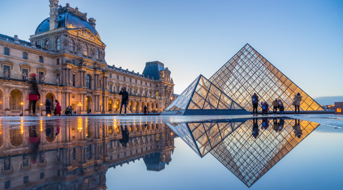 """""""iew of famous Louvre Museum with Louvre Pyramid at evening"""" stock image"""
