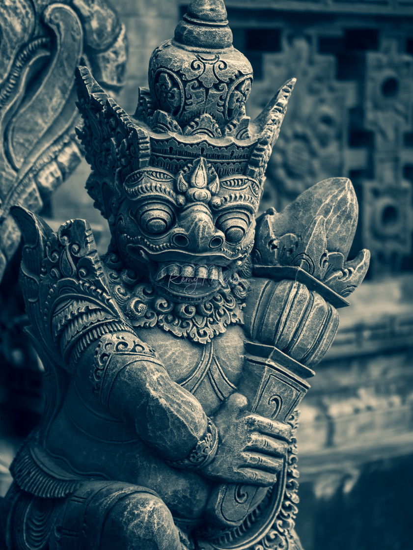 """Traditional stone statues depicting demons in Bali,Indonesia"" stock image"