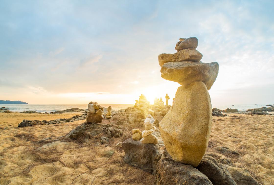 """""""Stones pyramid on sand symbolizing zen, harmony, balance in Kha"""" stock image"""