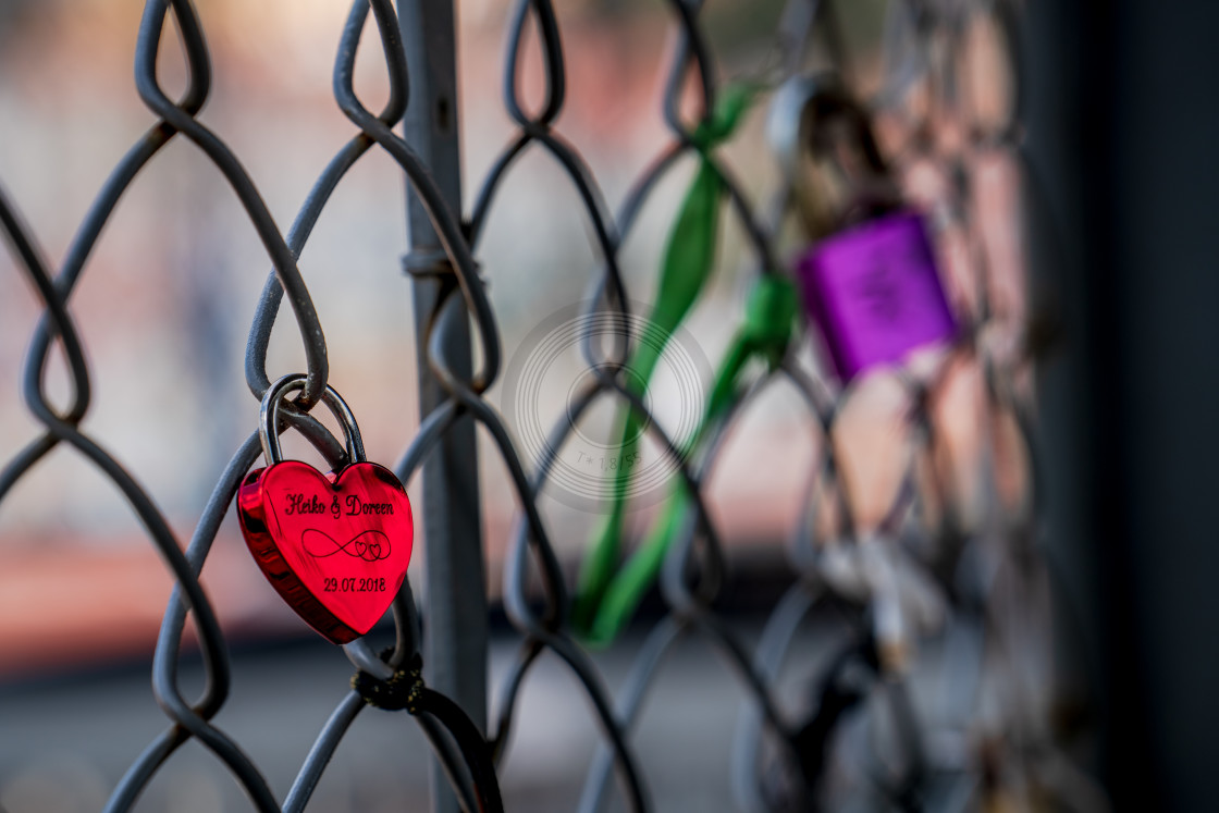 """Sweethearts locked to a fence"" stock image"