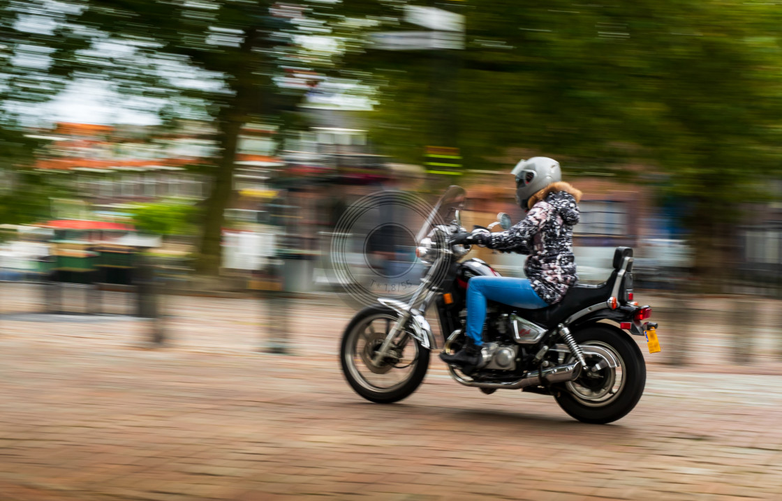 """Biker girl cruising"" stock image"