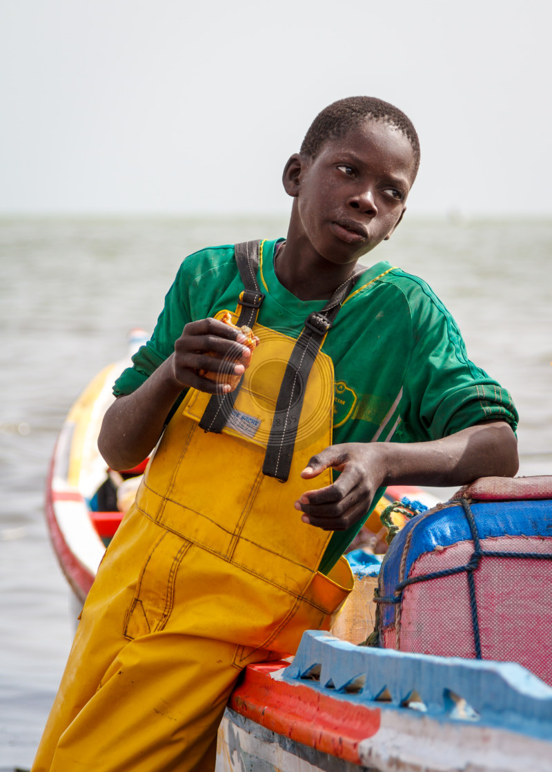 """""""Young fisherman eating snack"""" stock image"""
