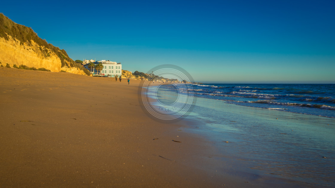 """Sun setting on an empty Albufeira beach"" stock image"
