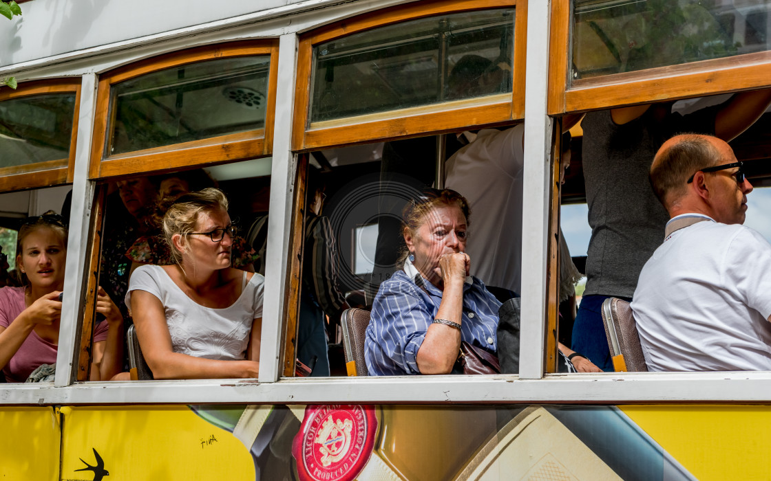 """Passengers sitting in a tram"" stock image"