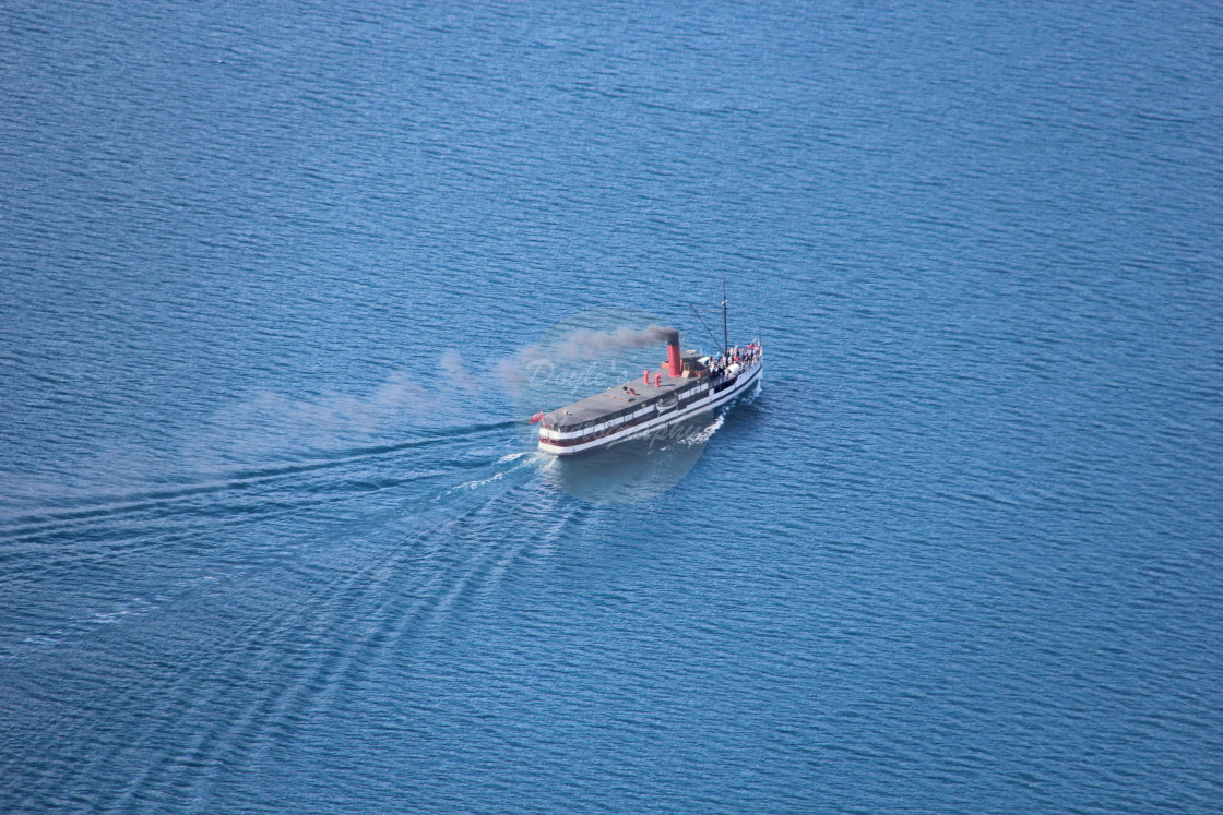 """Steamship On Mountain Lake"" stock image"