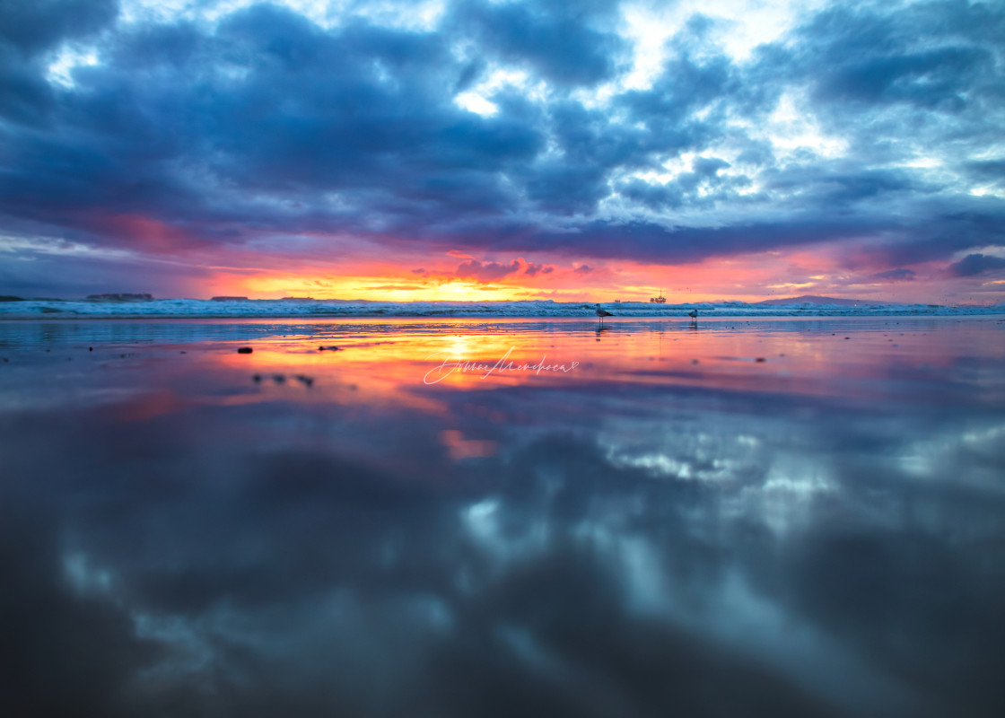 """stormy beach sunset cloud reflection"" stock image"