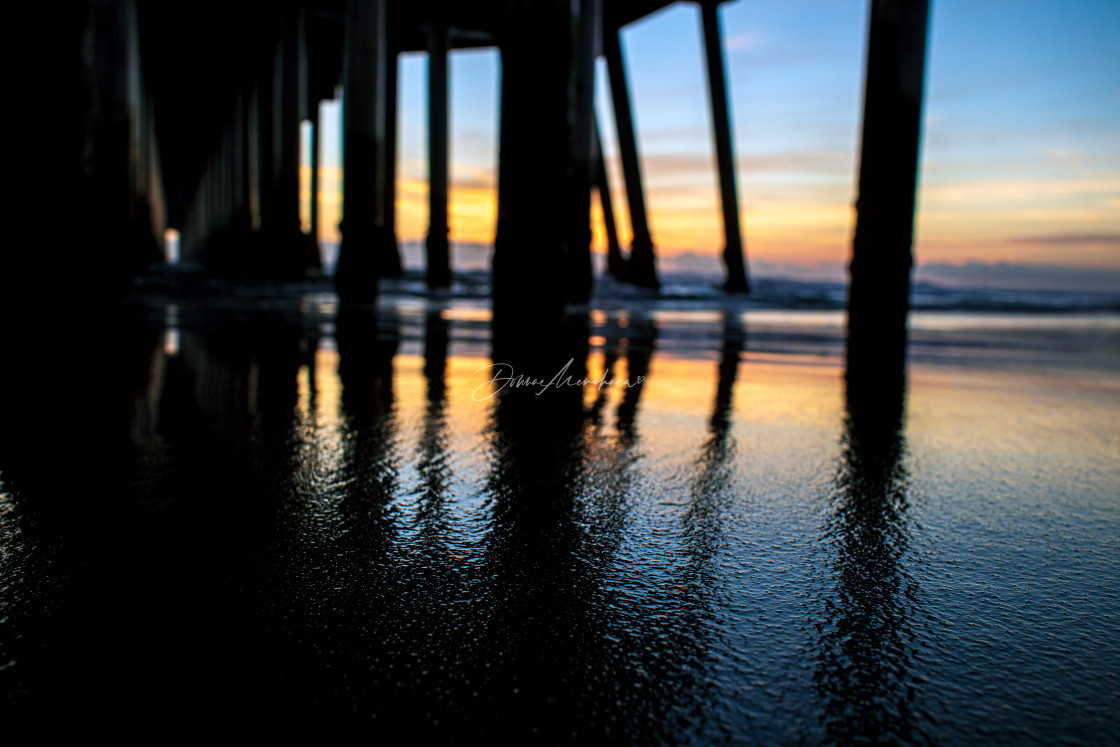 """Sunset under Huntington Beach Pier"" stock image"