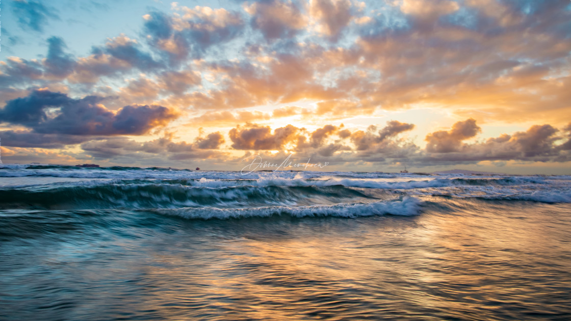 """""""Huntington Beach Sunset clouds and water blur"""" stock image"""