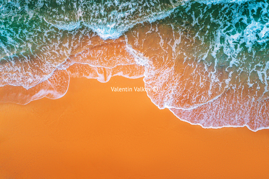 """""""Aerial view of sea waves and sandy beach"""" stock image"""