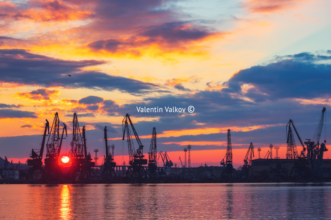 """Sea port and industrial cranes, Varna, Bulgaria.Sunset over the"" stock image"